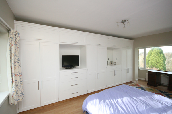 Rank Of Bespoke Wardrobes With Tv And Mirror Alcoves Cupboards And Drawers