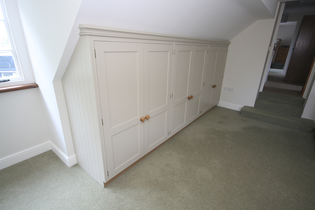 Wardrobes in an attic room with a pitched roof enlargement 1 An attic room