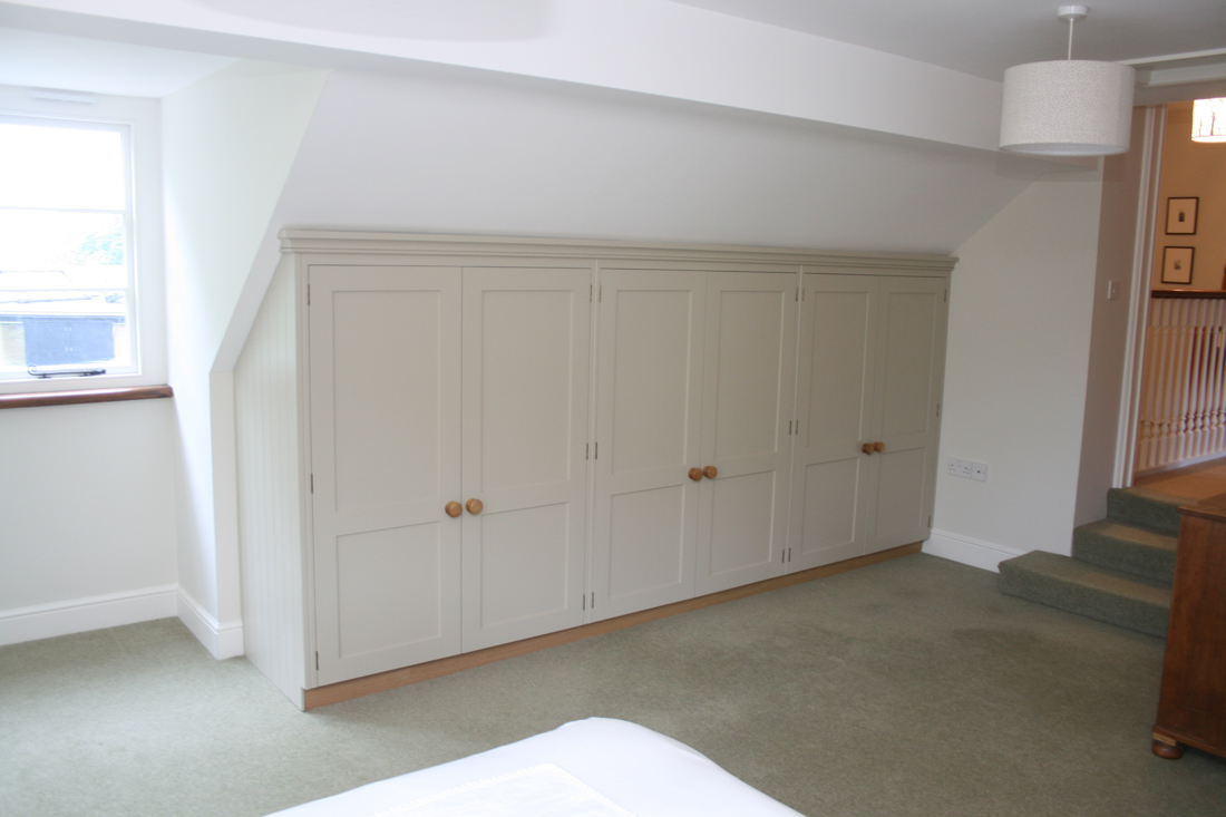 Wardrobes In An Attic Room With A Pitched Roof Enlargement 5